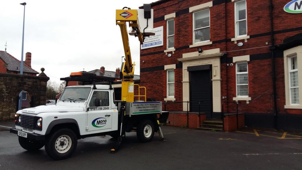 Cherry picker outside of building
